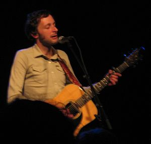 Scottish singer Alasdair Roberts at a concert ...