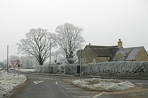 English: Road junction on a wintry New Year's ...