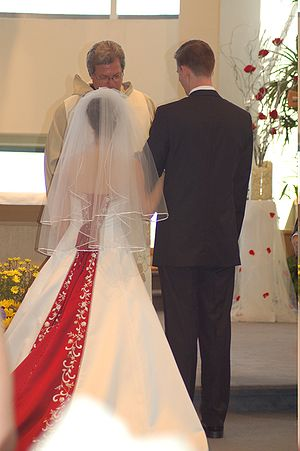 Bride and groom, backs facing the camera, in f...
