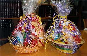Gaily wrapped baskets of sweets, drinks and ot...