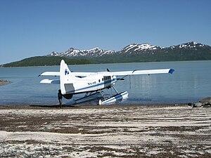 DeHaviland Otter N1018B beached tail-in. Plane...
