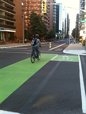 English: Green cycling lanes for making turns ...