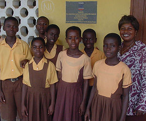 English: Headmistress and primary school stude...