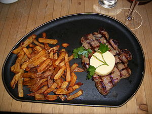 Sirloin steak, served with garlic butter and f...