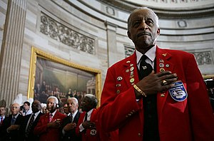 A member of the Tuskegee Airmen stands with hi...