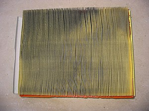 Used auto engine air filter, dirty side