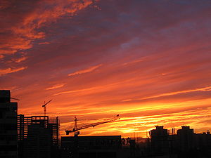 English: Silhouette of cranes and buildings, B...