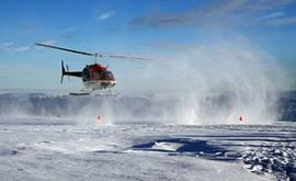 A helicopter is taking off Greenland Ice Sheet