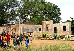 English: A school in Koindu damaged during the...