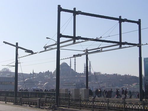 Tramway overhead at the double leaf bascule section of the Galata Bridge in Istanbul, Turkey (photo by Roger W Haworth, via Wikimedia Commons)