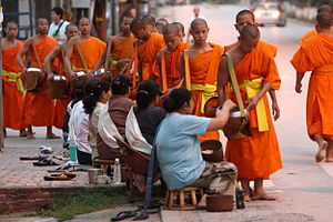 English: Monks collecting alms (in the form of...
