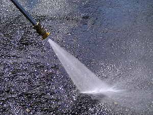 A Honda GX160 5.5 HP. pressure washer in action.