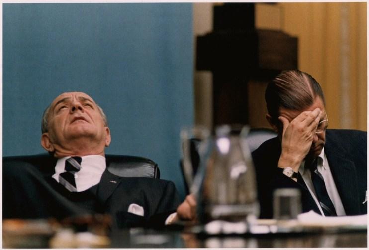 A photo of Lyndon Johnson and Robert McNamara looking perplexed