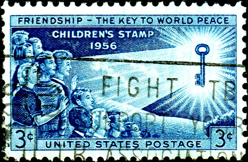 Scanned image of US stamp issued in 1956. Friendship is the key to world peace.