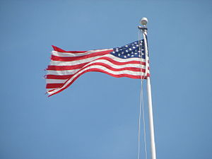 A waving American flag atop the United States ...