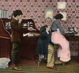 Early 20th century postcard shows office. Boss...