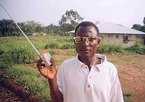 A radio listener in rural Kailahun Sierra Leone.
