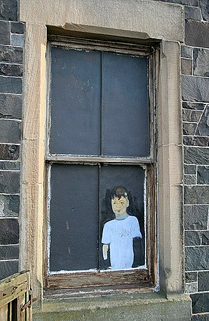 English: Artwork on a window On a blacked out ...