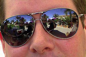 English: Closeup of man wearing Aviator-style ...