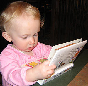 Young child with book.