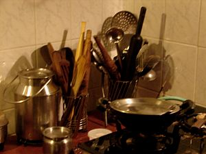 English: Pots, pans and rolling pins : a scene...