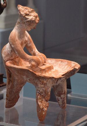 Terracotta statur woman kneading dough 5th cen...