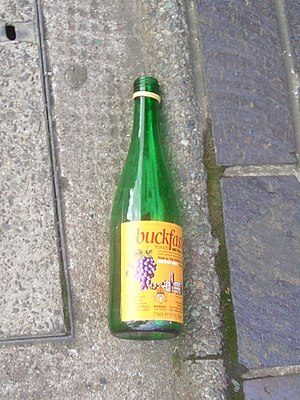 A bottle of Buckfast in the street. Buckfast's...