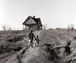 Two African-American children and their home l...