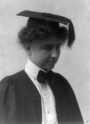 Helen Keller wearing graduation cap and gown. ...