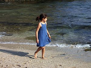 Inês, a Girl walking in the beach. Porto Covo,...