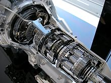 Cutaway car transmission, with exposed gears and internal machinery.