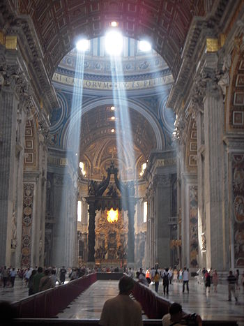 English: Crepuscular rays in Saint Peter's Bas...