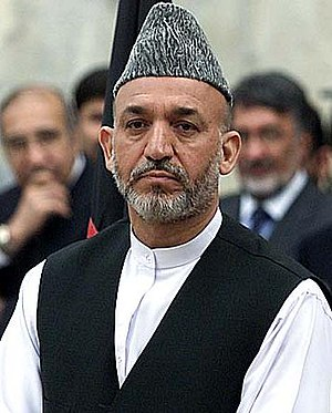 President of Afghanistan, Hamid Karzai, wearin...