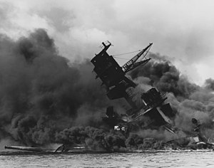The USS Arizona (BB-39) burning after the Japa...