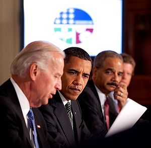 President Barack Obama listens as Vice Preside...