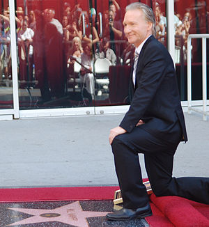 Bill Maher next to his star at a ceremony on t...