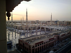 The sun rises over Medina, the prophet's city,...