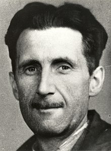 A photo showing head and shoulders of a middle-aged Caucasian man with a slim mustache.