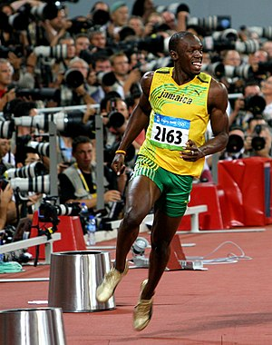 Usain Bolt in celebration after his 100m victo...
