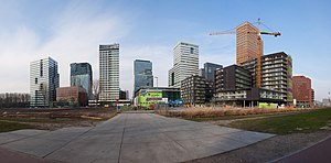 English: The Zuidas district is the main centre of business and...