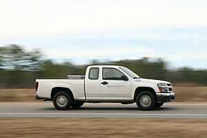 English: A white Chevrolet truck, numbered 130...