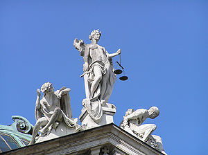 English: Justitia statue on top of the Palace ...