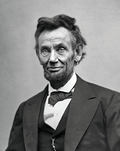 An older, tired-looking Abraham Lincoln with a beard.