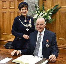 Dame Patsy Reddy and Sir David Gascoigne sign the Visitors' Book at Parliament House, Wellington, 2016