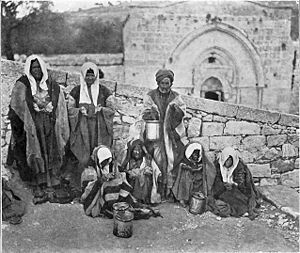 English: Lepers in Jerusalem 1913 outside Mary...