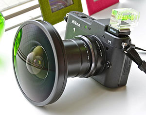 English: Nikon 1 V1 with Nikon FC-E9 fisheye l...