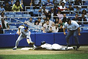 Rickey Henderson steals third base for the New...