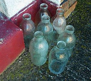 English: Seven modern Dairy Crest milk bottles.