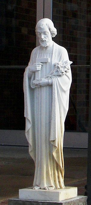 An iconic statue of St. Joseph with the carpen...