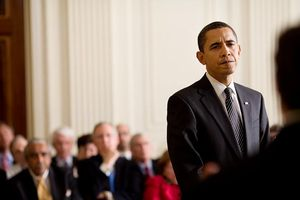 President Barack Obama listens to a question f...